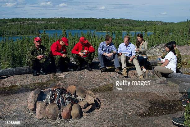 Prince William Duke of Cambridge and Catherine Duchess of Cambridge eat a lunch of Arctic Char with members of the Canadian Rangers and Canadian...