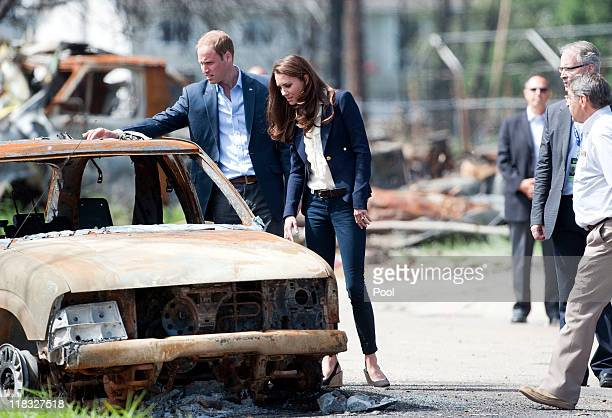 Prince William, Duke of Cambridge and Catherine, Duchess of Cambridge inspect a fire-damaged car in a part of town devastated by a fire in May 2011,...