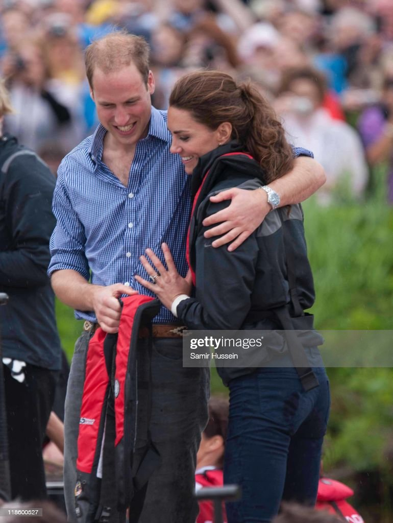 Prince William, Duke of Cambridge and Catherine, Duchess of Cambridge hug after taking part in a dragon boat race at Dalvay-by-the-sea on day 5 of the Royal Couple's North American Tour, July 4, 2011 in Charlottetown, Prince Edward Island, Canada.