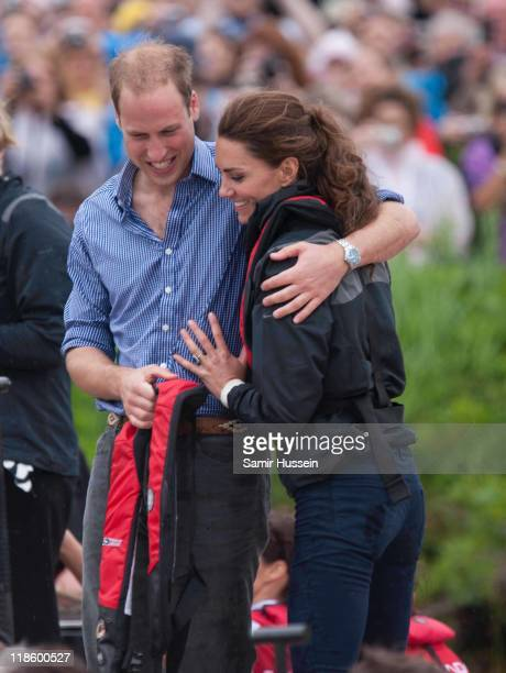Prince William Duke of Cambridge and Catherine Duchess of Cambridge hug after taking part in a dragon boat race at Dalvaybythesea on day 5 of the...