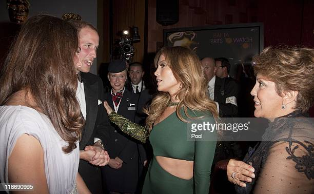 Prince William Duke of Cambridge and Catherine Duchess of Cambridge speaks to Jennifer Lopez and her mother Guadalupe Lopez at the 2011 BAFTA Brits...