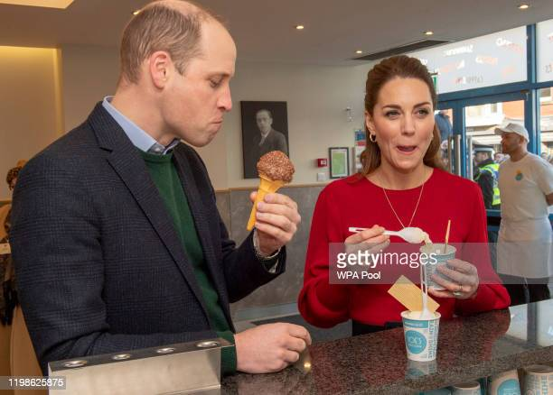Prince William, Duke of Cambridge and Catherine, Duchess of Cambridge eat ice cream during a visit to Joe's Ice Cream Parlour in the Mumbles to meet...