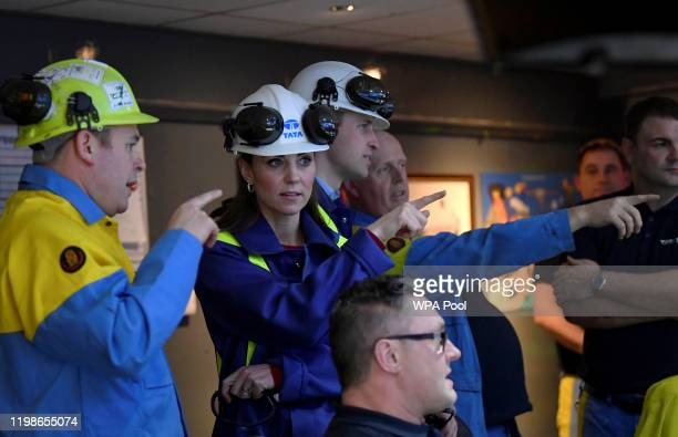 Prince William Duke of Cambridge and Catherine Duchess of Cambridge gesture with Works Manager Carl Banfield as they visit the control centre at Tata...