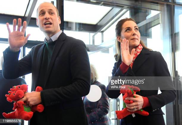 Prince William Duke of Cambridge and Catherine Duchess of Cambridge wave goodbye holding dragon toys they received for their children after their...