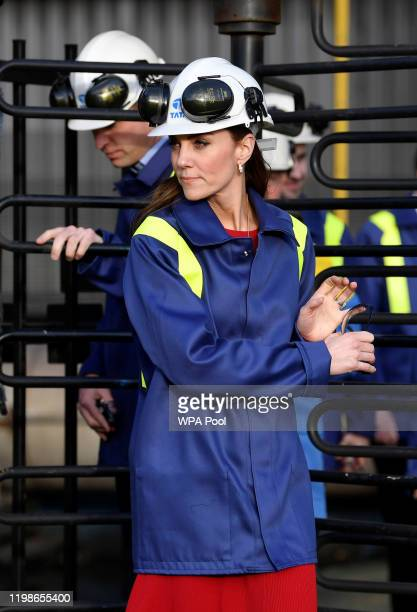 Prince William Duke of Cambridge and Catherine Duchess of Cambridge go through a turnstile during a visit to Tata Steel on February 04 2020 in Port...