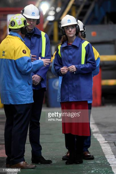 Prince William Duke of Cambridge and Catherine Duchess of Cambridge talk with Hub Director Martin Brunnock and Works Manager Carl Banfield during a...