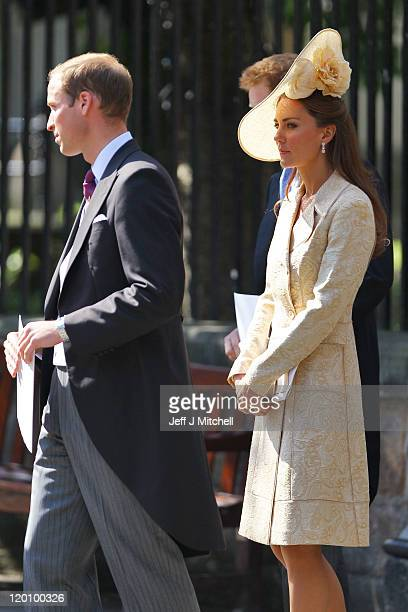 Prince William, Duke of Cambridge and Catherine, Duchess of Cambridge depart after the Royal wedding of Zara Phillips and Mike Tindall at Canongate...