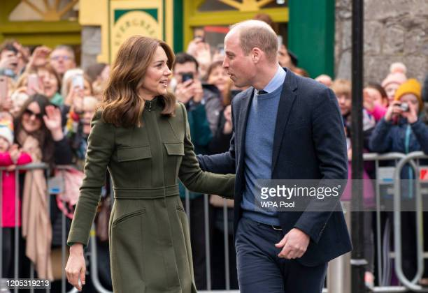 Prince William, Duke of Cambridge and Catherine, Duchess of Cambridge chat as they meet members of the public gathered on King Street during day...