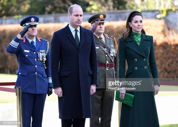 Prince William, Duke of Cambridge and Catherine, Duchess of Cambridge attend a commemorative wreath laying ceremony in the Garden of Remembrance at...