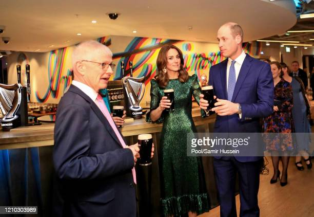 Prince William, Duke of Cambridge and Catherine, Duchess of Cambridge hold a pint of Guinness as they visit the Guinness Storehouse's Gravity Bar...