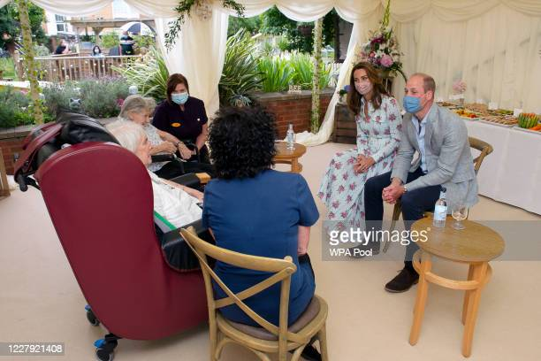 Prince William Duke of Cambridge and Catherine Duchess of Cambridge listen to Joan Drew Smith as she tells the Royal couple what she thought of their...