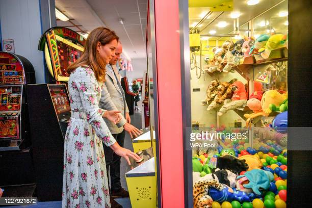 Prince William Duke of Cambridge and Catherine Duchess of Cambridge play a grab a teddy game as the Duchess picks up a blue toy and celebrates only...