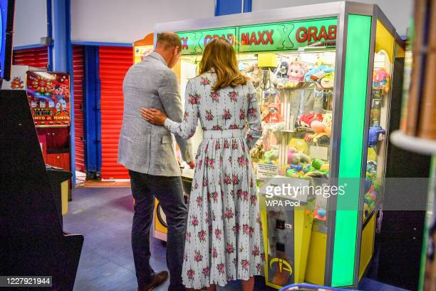 Prince William Duke of Cambridge and Catherine Duchess of Cambridge play a grab a teddy game at Island Leisure Amusement Arcade where Gavin and...