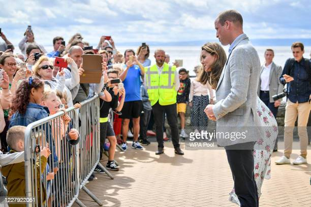 Prince William Duke of Cambridge and Catherine Duchess of Cambridge chat with members of the public during their visit to Barry Island South Wales to...