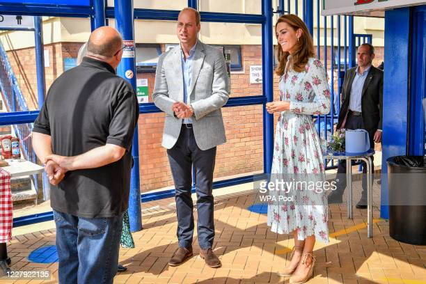 Prince William Duke of Cambridge and Catherine Duchess of Cambridge meet owner of Marco's cafe Marco Zeraschi during their visit to Barry Island...