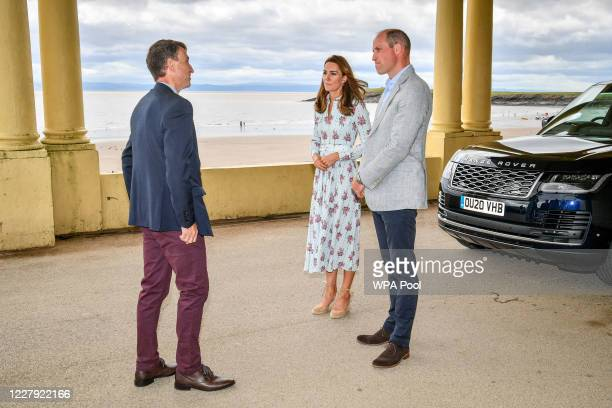 Prince William Duke of Cambridge and Catherine Duchess of Cambridge meet with MD of Vale of Glamorgan Council Rob Thomas as they arrive by car to...