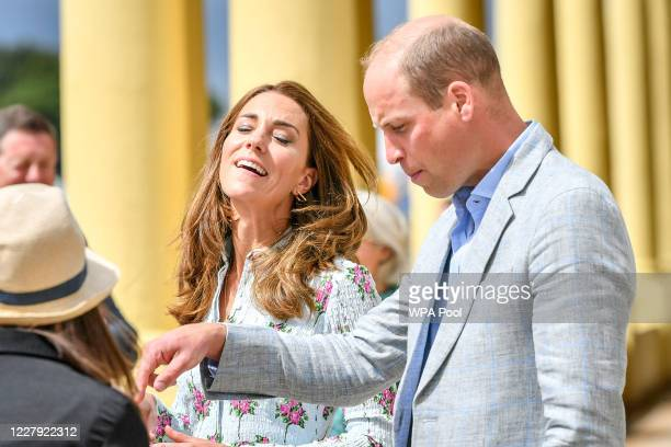 Prince William Duke of Cambridge and Catherine Duchess of Cambridge on the promenade as they visit beach huts during their visit to Barry Island...