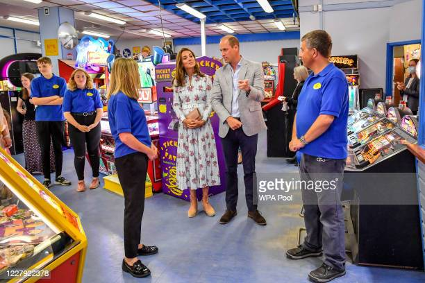Prince William Duke of Cambridge and Catherine Duchess of Cambridge chat with staff at Island Leisure Amusement Arcade where Gavin and Stacey was...