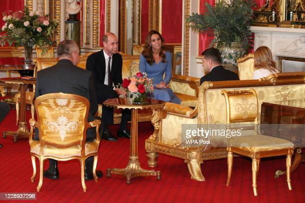 Prince William, Duke of Cambridge and Catherine, Duchess of Cambridge talk with Ukraine's President Volodymyr Zelensky and his wife Olena during an...
