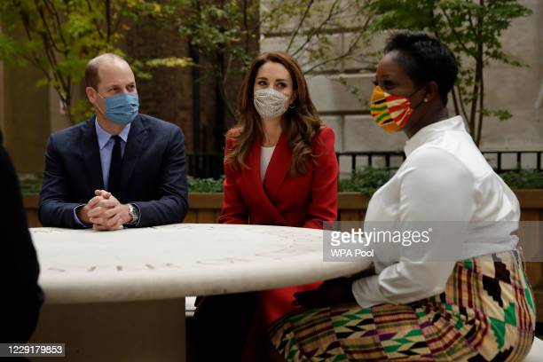 Prince William Duke of Cambridge and Catherine Duchess of Cambridge meet pharmacist Joyce Duah at St Bartholomew's Hospital during an event to mark...