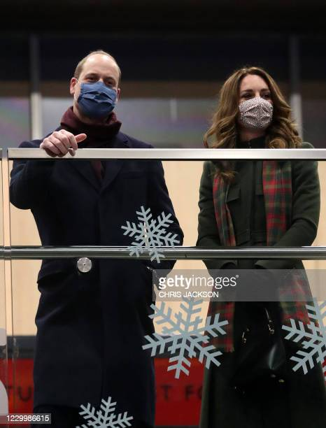 Prince William, Duke of Cambridge and Catherine, Duchess of Cambridge look on from the balcony at London Euston Station in London, England on...