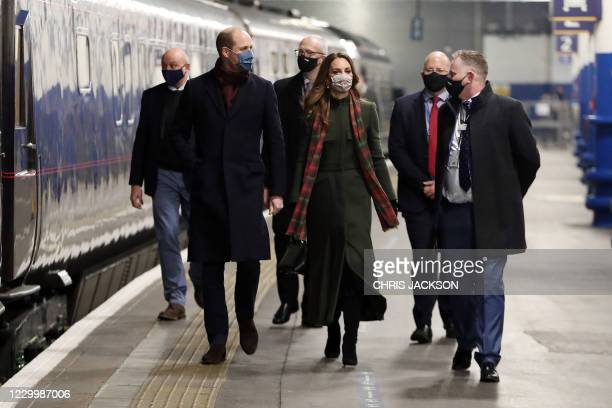 Prince William, Duke of Cambridge and Catherine, Duchess of Cambridge board the Royal train at London Euston Station in London, England on December...