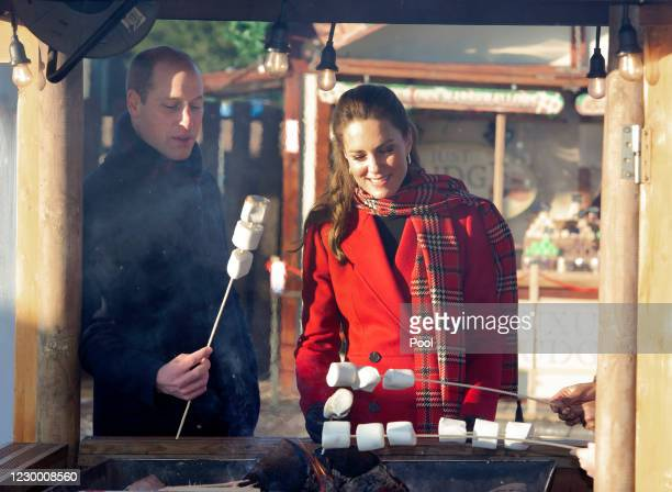 Prince William, Duke of Cambridge and Catherine, Duchess of Cambridge toast marshmallows during a visit to Cardiff Castle to meet local university...