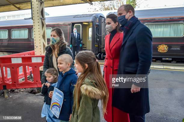 Prince William, Duke of Cambridge and Catherine, Duchess of Cambridge arrive at Bath Spa train station and take time to meet and chat with Otto...