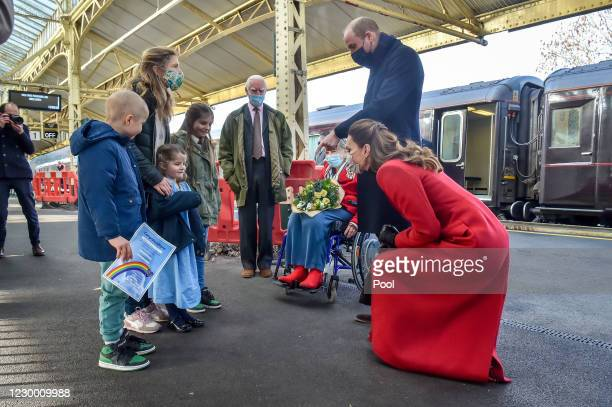Prince William, Duke of Cambridge and Catherine, Duchess of Cambridge arrive at Bath Spa train station and take time to meet and chat with Jasmine...