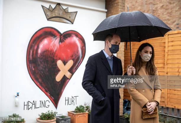 Prince William, Duke of Cambridge and Catherine, Duchess of Cambridge talk with members of the ambulance service in the well being garden during a...