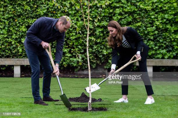 Prince William, Duke of Cambridge and Catherine, Duchess of Cambridge take part in planting a tree during a visit to the University of St Andrews on...
