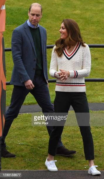 Prince William, Duke of Cambridge and Catherine, Duchess of Cambridge arrive to meet local schoolchildren as they take part in the Lawn Tennis...