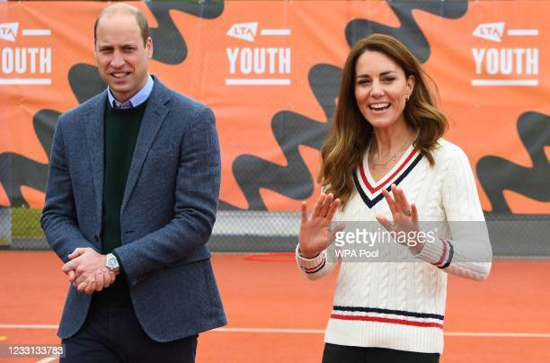 Prince William, Duke of Cambridge and Catherine, Duchess of Cambridge speak to schoolchildren taking part in the Lawn Tennis Association's Youth...