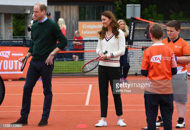Prince William, Duke of Cambridge and Catherine, Duchess of Cambridge join local schoolchildren as they take part in the Lawn Tennis Association's...