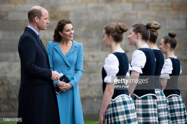 Prince William, Duke of Cambridge and Catherine, Duchess of Cambridge meet Highland dancers during a Beating of the Retreat at the Palace of...