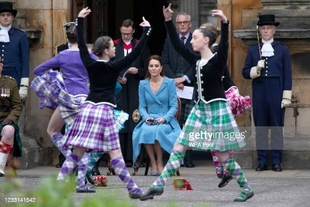 Prince William, Duke of Cambridge and Catherine, Duchess of Cambridge watch Highland dancers perform during a Beating of the Retreat at the Palace of...