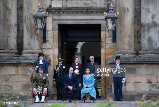 Prince William, Duke of Cambridge and Catherine, Duchess of Cambridge sit with Lieutenant Colonel Craig Stewart , during a Beating of the Retreat at...