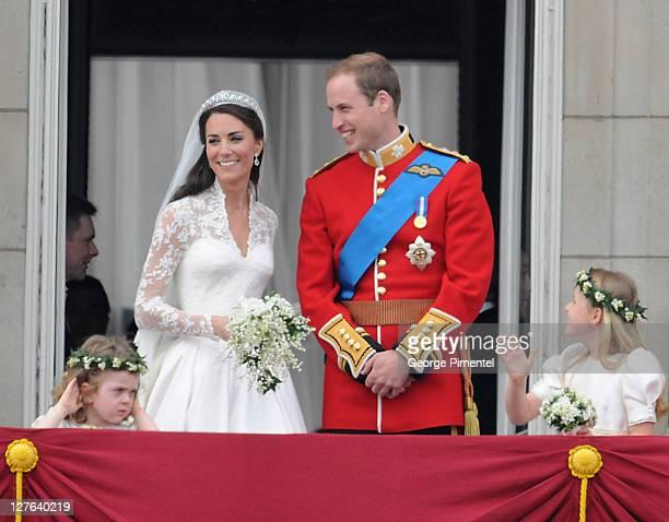Prince William, Duke of Cambridge and Catherine, Duchess of Cambridge greet wellwishers from the balcony next to Grace Van Cutsem and Margarita...