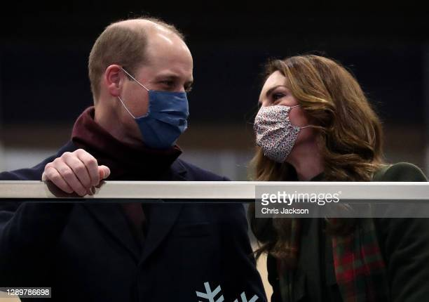 Prince William, Duke of Cambridge and Catherine, Duchess of Cambridge look on from the balcony at London Euston Station on December 06, 2020 in...