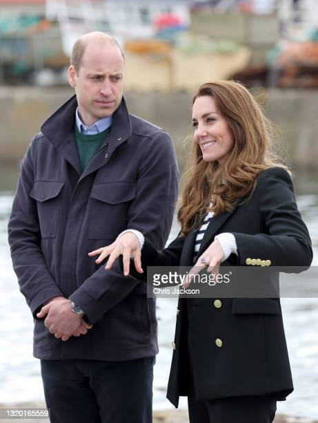 Prince William, Duke of Cambridge and Catherine, Duchess of Cambridge speak with local fishermen and their families to hear about the work of fishing...