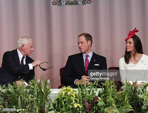 Prince William, Duke of Cambridge and Catherine, Duchess of Cambridge share a conversation with Governor General David Johnston during Canada Day...