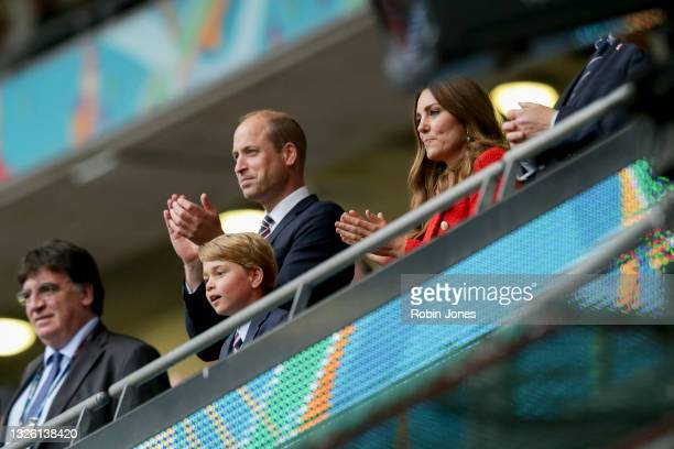 Prince William, Duke of Cambridge and Catherine, Duchess of Cambridge with their son Prince George after England's 2-0 win during the UEFA Euro 2020...