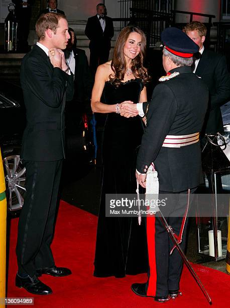 Prince William, Duke of Cambridge and Catherine, Duchess of Cambridge are greeted by Sir David Brewer, Lord-Lieutenant of Greater London, as they...