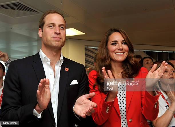 Prince William Duke of Cambridge and Catherine Duchess of Cambridge applaud the gold medal victory by the Team GB Men's Team Pursuit in the Track...