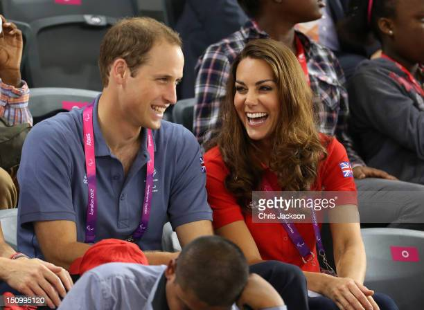 Prince William Duke of Cambridge and Catherine Duchess of Cambridge share a joke as they clap whilst watching the track cycling on day 1 of the...