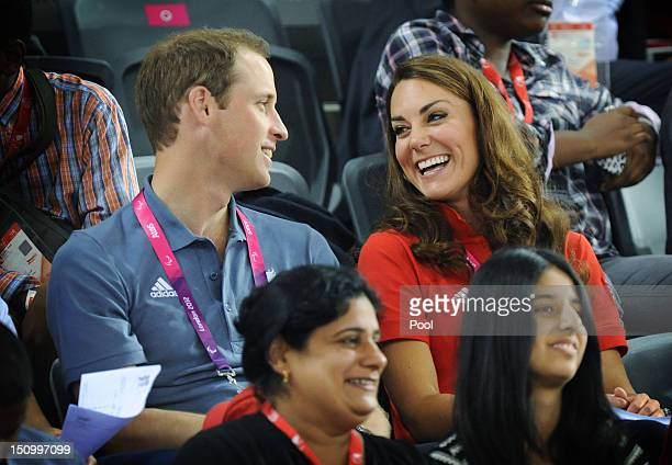 Prince William, Duke of Cambridge and Catherine, Duchess of Cambridge talk as they watch the cycling in the Velodrome during Day 1 of the London 2012...