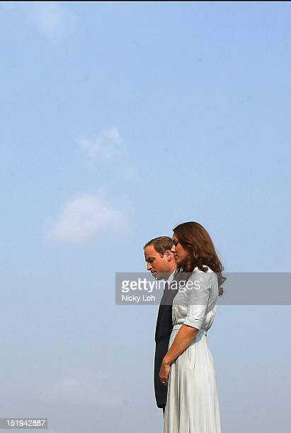 Prince William Duke of Cambridge and Catherine Duchess of Cambridge visit the Kranji War Memorial during their Diamond Jubilee tour on September 13...