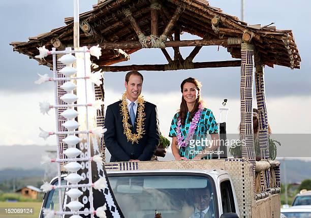 Prince William, Duke of Cambridge and Catherine, Duchess of Cambridge travel in a special boat vehicle as they arrive at Honiara International...