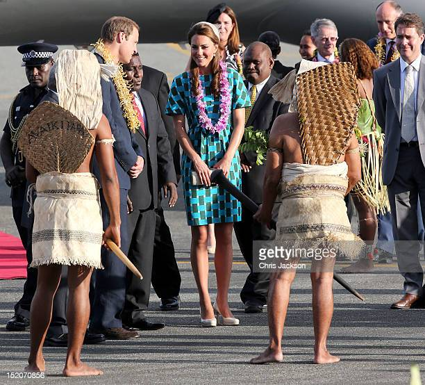Prince William, Duke of Cambridge and Catherine, Duchess of Cambridge twatch traditional dancing as they arrive at Honiara International Airport...