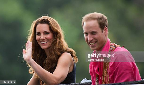 Prince William Duke of Cambridge and Catherine Duchess of Cambridge arrive by boat to visit Tuvanipupu Island on their Diamond Jubilee tour of the...